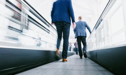 business people using a escalator on a  trade show- Stock Photo or Stock Video of rcfotostock | RC-Photo-Stock