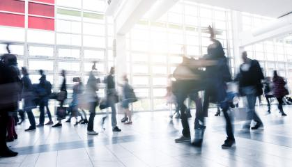 Business People Walking at Rush Hour on a traid fair flloor- Stock Photo or Stock Video of rcfotostock | RC-Photo-Stock