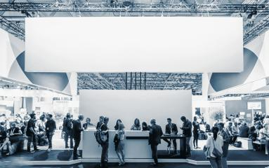 business people walking between trade show booths at a public event exhibition hall, with banner and copy space for individual text - Stock Photo or Stock Video of rcfotostock | RC-Photo-Stock