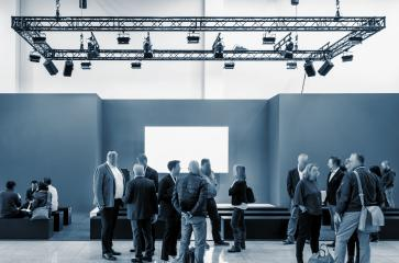 business people walking between trade show booths at a public event exhibition hall and copy space for individual text - Stock Photo or Stock Video of rcfotostock | RC-Photo-Stock