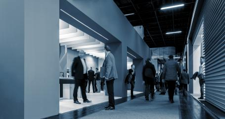 Business People Walking between trade show stands- Stock Photo or Stock Video of rcfotostock | RC-Photo-Stock