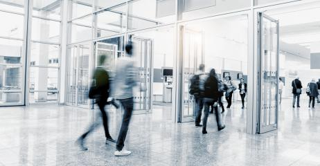 business people walking in a entrance at a trade show. ideal for websites and magazines layouts- Stock Photo or Stock Video of rcfotostock | RC-Photo-Stock