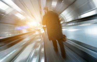 business traveler using a smartphone at escalator- Stock Photo or Stock Video of rcfotostock | RC-Photo-Stock