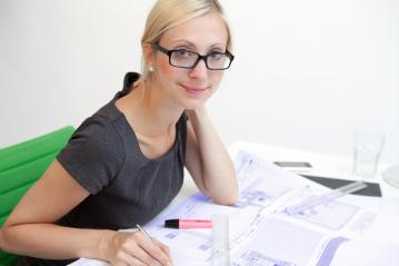 Business woman with blueprint- Stock Photo or Stock Video of rcfotostock | RC-Photo-Stock