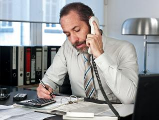Businessman calculating finance- Stock Photo or Stock Video of rcfotostock | RC-Photo-Stock