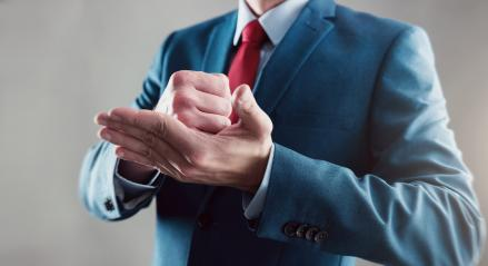 businessman celebrating success clenched fist on his hand- Stock Photo or Stock Video of rcfotostock | RC-Photo-Stock