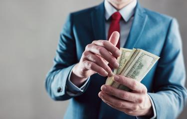 Businessman counting dollar notes- Stock Photo or Stock Video of rcfotostock | RC-Photo-Stock