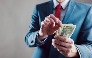 Businessman counting spread of money - Stock Photo or Stock Video of rcfotostock | RC-Photo-Stock
