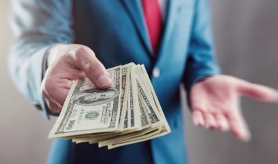 Businessman displaying a Spread of Cash : Stock Photo or Stock Video Download rcfotostock photos, images and assets rcfotostock   RC-Photo-Stock.: