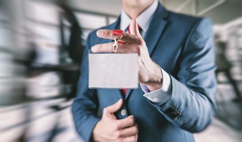 Businessman holding a Trade Fair entrance card on a lanyard- Stock Photo or Stock Video of rcfotostock | RC-Photo-Stock