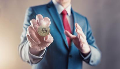 Businessman offers bitcoin - bit coin BTC the new virtual money- Stock Photo or Stock Video of rcfotostock | RC-Photo-Stock