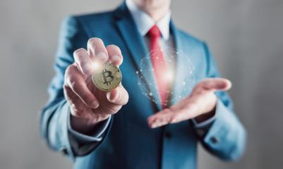 Businessman present a bitcoin - Bitcoin growth concept (new virtual money) - Stock Photo or Stock Video of rcfotostock | RC-Photo-Stock