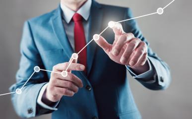 Businessman touching a growing graph- Stock Photo or Stock Video of rcfotostock | RC-Photo-Stock