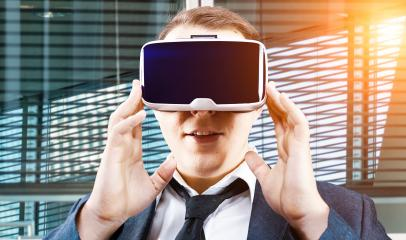 Businessman uses Virtual Reality VR head mounted display- Stock Photo or Stock Video of rcfotostock | RC-Photo-Stock
