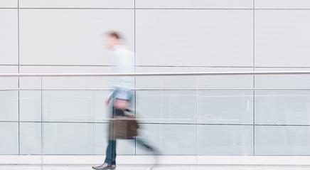 Businessman walks in a futuristic corridor- Stock Photo or Stock Video of rcfotostock | RC-Photo-Stock