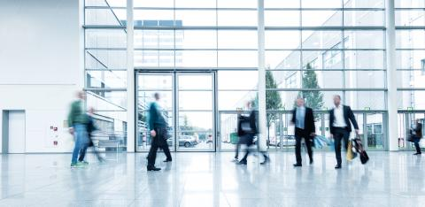 businesspeople walking in the corridor of an Exhibition- Stock Photo or Stock Video of rcfotostock | RC-Photo-Stock