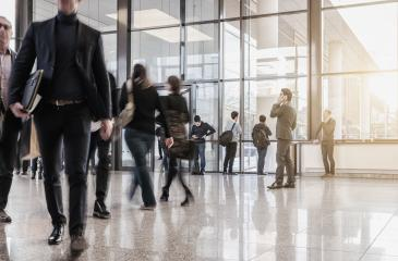 businesspeople walking in the corridor of an trade fair- Stock Photo or Stock Video of rcfotostock | RC-Photo-Stock