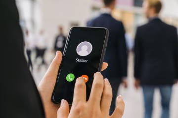 Businesswoman gets a Phone call from a stalker. Stalking or bullying with smartphone concept. Stalker caller, scammer or stranger. Woman answering to incoming call. Ex boyfriend with fake identity.- Stock Photo or Stock Video of rcfotostock | RC-Photo-Stock