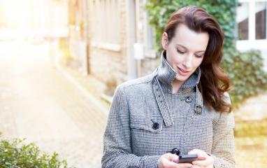 Businesswoman use her mobile phone- Stock Photo or Stock Video of rcfotostock | RC-Photo-Stock