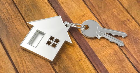 Buying a house with two home keys on a wood floor background- Stock Photo or Stock Video of rcfotostock | RC-Photo-Stock
