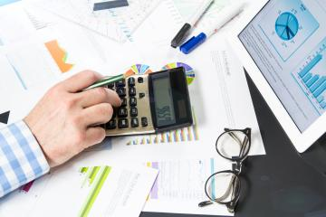 Calculating with business documents : Stock Photo or Stock Video Download rcfotostock photos, images and assets rcfotostock | RC-Photo-Stock.: