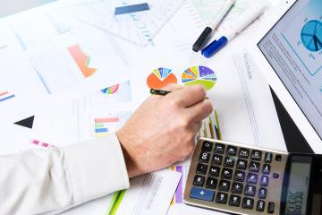 Calculating with business documents- Stock Photo or Stock Video of rcfotostock | RC-Photo-Stock