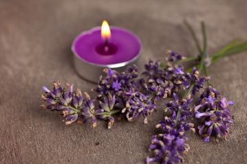 candel with flamme with lavender- Stock Photo or Stock Video of rcfotostock | RC-Photo-Stock