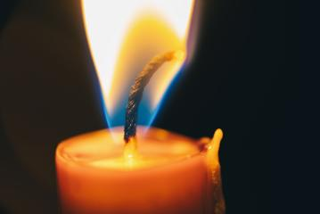 Candle flame close up on a black background - Stock Photo or Stock Video of rcfotostock | RC-Photo-Stock