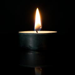 Candle Lit or Tealight is Burning on black background- Stock Photo or Stock Video of rcfotostock | RC-Photo-Stock