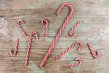 candy cane striped in Christmas colours on wooden background- Stock Photo or Stock Video of rcfotostock | RC-Photo-Stock