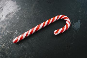 candy canes in Christmas colours on a dark surface- Stock Photo or Stock Video of rcfotostock | RC-Photo-Stock