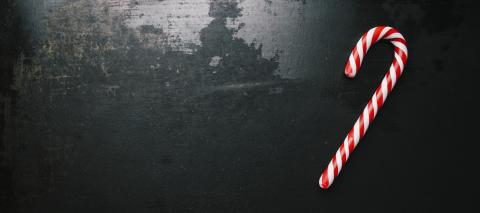 candy canes in Christmas colours on a dark surface, including copy space- Stock Photo or Stock Video of rcfotostock | RC-Photo-Stock
