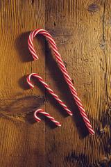 candy canes in Christmas colours on wooden background : Stock Photo or Stock Video Download rcfotostock photos, images and assets rcfotostock | RC-Photo-Stock.: