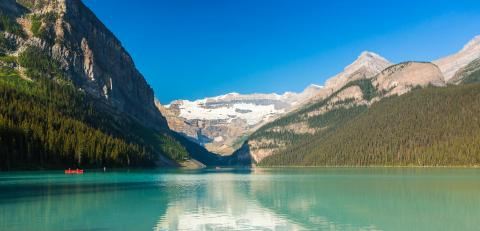 Canoeing at Lake Louise at the Rocky Mountains - Stock Photo or Stock Video of rcfotostock | RC-Photo-Stock