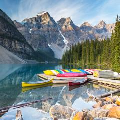 Canoes on a jetty at  Moraine lake in Banff National Park, Alberta, Canada, with snow-covered peaks of canadian Rocky Mountains in the background : Stock Photo or Stock Video Download rcfotostock photos, images and assets rcfotostock | RC-Photo-Stock.: