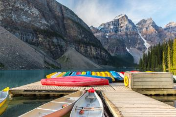 Canoes on Moraine Lake in the Banff National Park canada : Stock Photo or Stock Video Download rcfotostock photos, images and assets rcfotostock | RC-Photo-Stock.: