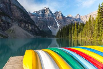 Canoes rest on the dock at Lake Moraine in the morning in canada : Stock Photo or Stock Video Download rcfotostock photos, images and assets rcfotostock | RC-Photo-Stock.: