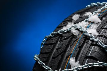 Car tire with ice and snow chains on blue background : Stock Photo or Stock Video Download rcfotostock photos, images and assets rcfotostock | RC-Photo-Stock.: