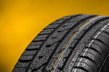 Car tire with raindrops summer tire aquaplaning : Stock Photo or Stock Video Download rcfotostock photos, images and assets rcfotostock | RC-Photo-Stock.: