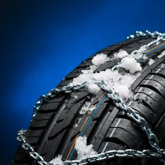 car tire with snow and snow chain  in winter on blue background : Stock Photo or Stock Video Download rcfotostock photos, images and assets rcfotostock | RC-Photo-Stock.:
