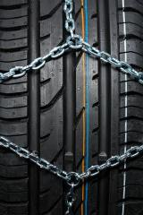Car tire with snow chains : Stock Photo or Stock Video Download rcfotostock photos, images and assets rcfotostock | RC-Photo-Stock.: