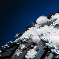 Car tire with snow chains and ice on blue background : Stock Photo or Stock Video Download rcfotostock photos, images and assets rcfotostock | RC-Photo-Stock.: