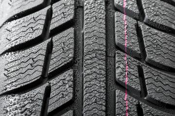 Car tires close-up Winter wheel profile structure with waterdrops : Stock Photo or Stock Video Download rcfotostock photos, images and assets rcfotostock | RC-Photo-Stock.: