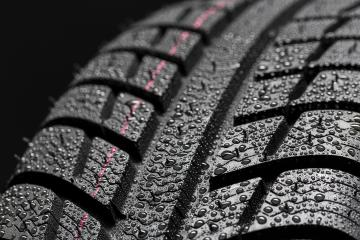 Car tires close-up Winter wheel profile structure with waterdrops on blue black background : Stock Photo or Stock Video Download rcfotostock photos, images and assets rcfotostock | RC-Photo-Stock.: