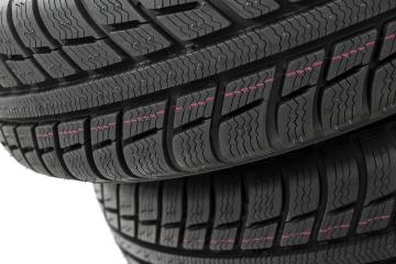 Car tires mature stack close-up Winter wheel profile structure on white background- Stock Photo or Stock Video of rcfotostock | RC-Photo-Stock