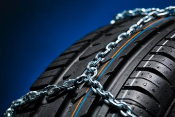 Car tyre with snow chain for winter  : Stock Photo or Stock Video Download rcfotostock photos, images and assets rcfotostock | RC-Photo-Stock.: