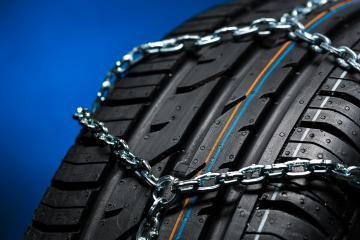 Car tyre with snow chain in the winter  : Stock Photo or Stock Video Download rcfotostock photos, images and assets rcfotostock | RC-Photo-Stock.: