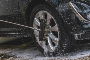 Car washing with soap and brush. Wheel aloy cleaning at car wash station- Stock Photo or Stock Video of rcfotostock | RC-Photo-Stock