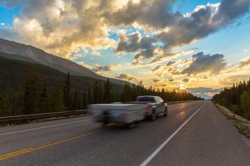 Caravan or recreational vehicle motor home trailer on a mountain road in Canada at sunset- Stock Photo or Stock Video of rcfotostock | RC-Photo-Stock