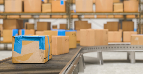 Cardboard boxes on conveyor belt in distribution warehouse- Stock Photo or Stock Video of rcfotostock | RC-Photo-Stock